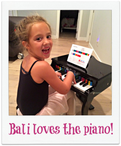 Bali loves the Schoenhut piano
