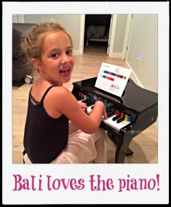 Bali loves the Schoenhut piano