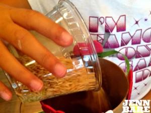 Pour rice into rainstick